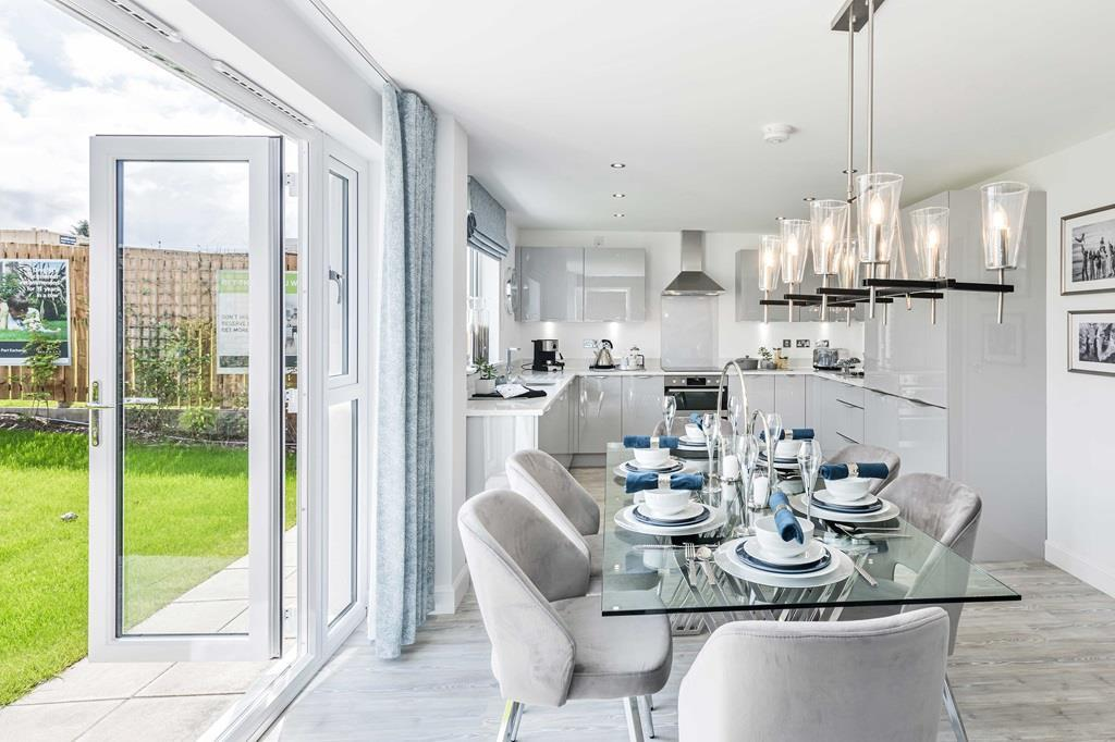 Kitchen/dining room with french doors leading to the garden of the 4 bed detached home,  The Cullen