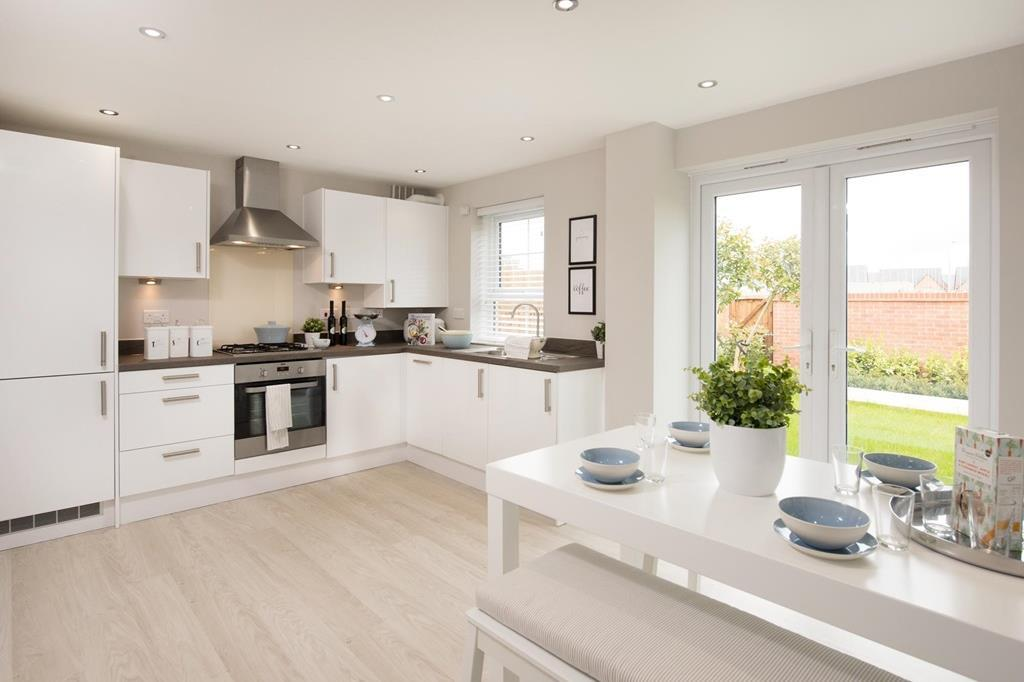 Internal shot of Moresby kitchen with French doors to garden