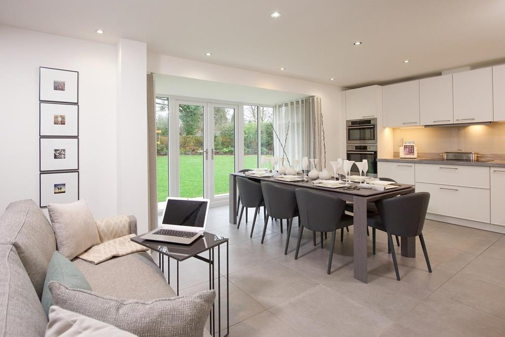 Open plan kitchen with family/dining areas and glazed bay with French doors