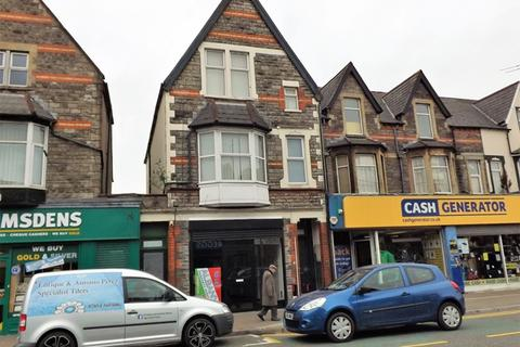 Shop to rent - ROATH - Lock up A1 shop unit on busy Albany Road, affording approx 540 square feet retail area