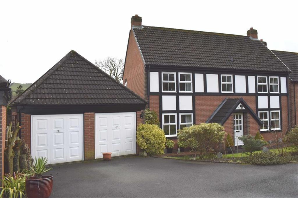 4 Bedrooms Detached House for sale in 14, Dolerw Park Drive, Milford Road, Newtown, Powys, SY16