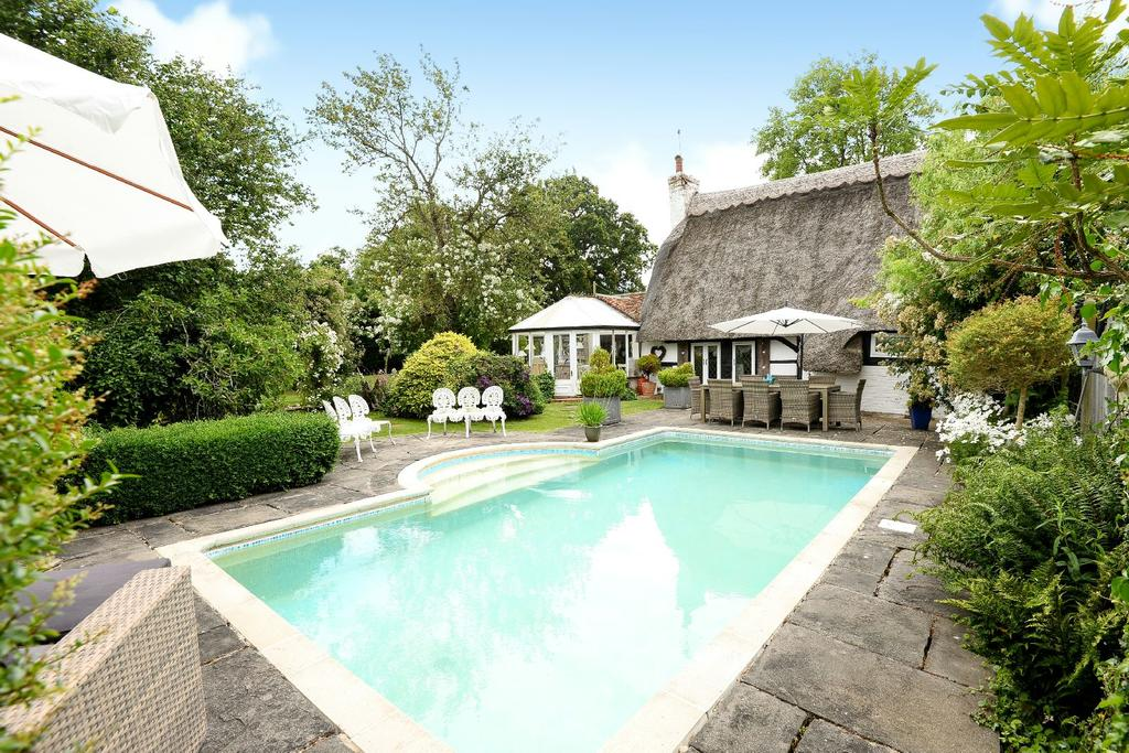 A perfect thatched cottage with a fairytale garden pool for Pool garden outlet