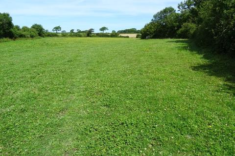 Land for sale - Approx 19.70 acres of agricultural land with a substantial range of stables at Llysworney