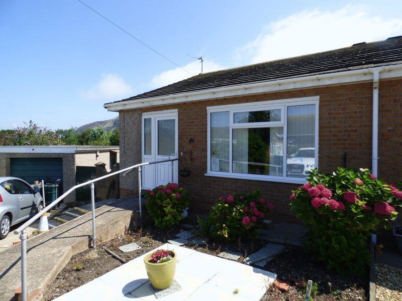 2 Bedrooms Semi Detached Bungalow for sale in 29 Cae Gwynan, Penmaenmawr LL34 6TR