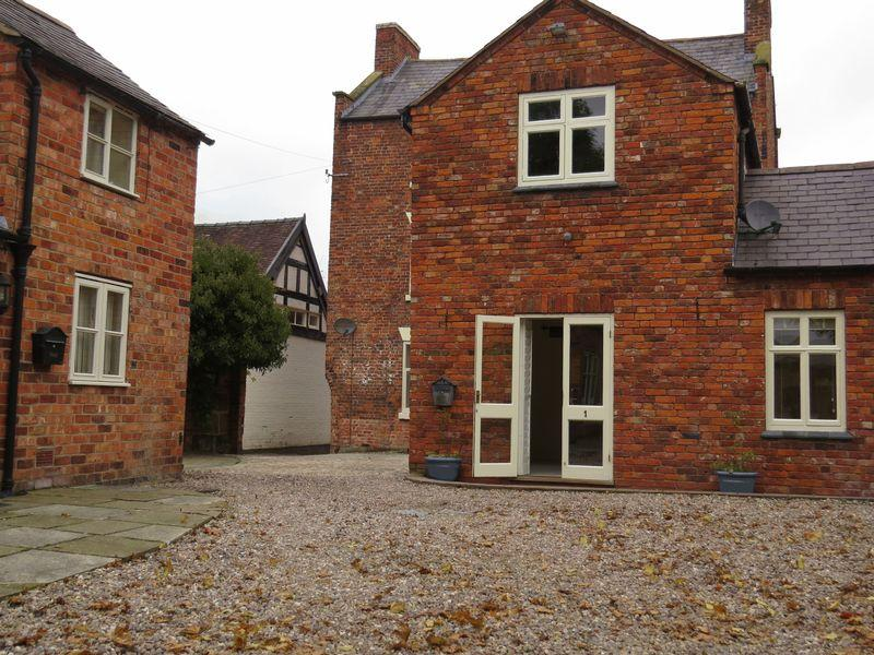 2 Bedrooms Terraced House for sale in Grove End Court, High Street, Wem, Shropshire. SY4 5EN