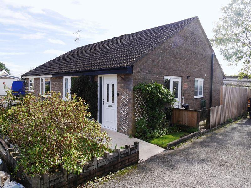 2 Bedrooms Semi Detached Bungalow for sale in Ash Walk, New Park, Talbot Green, CF72 8QN