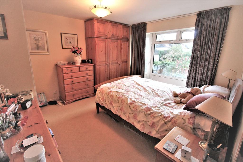 Bedroom On First Floor With Door to Balcony