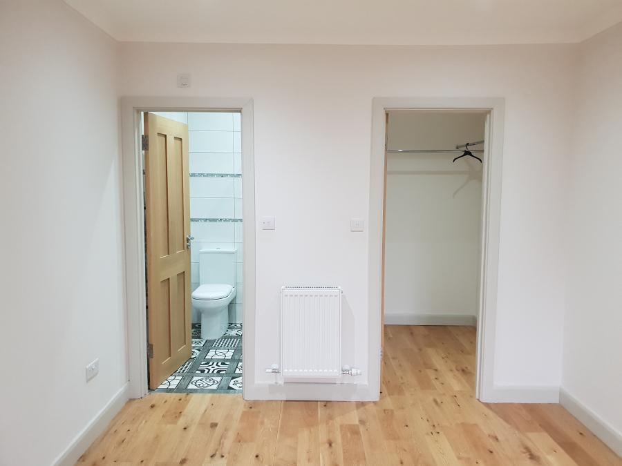 Master bedroom en suite and walk in wardrobe (bed