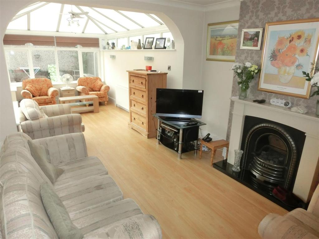 Lounge with open conservatory off