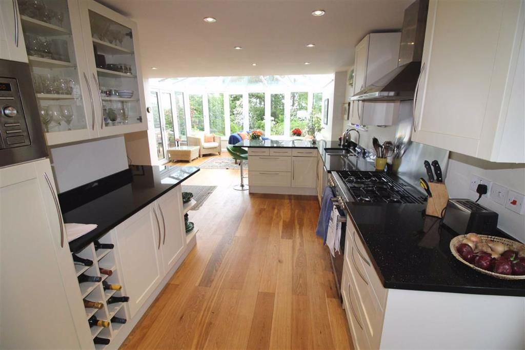 Fitted kitchen with utility area