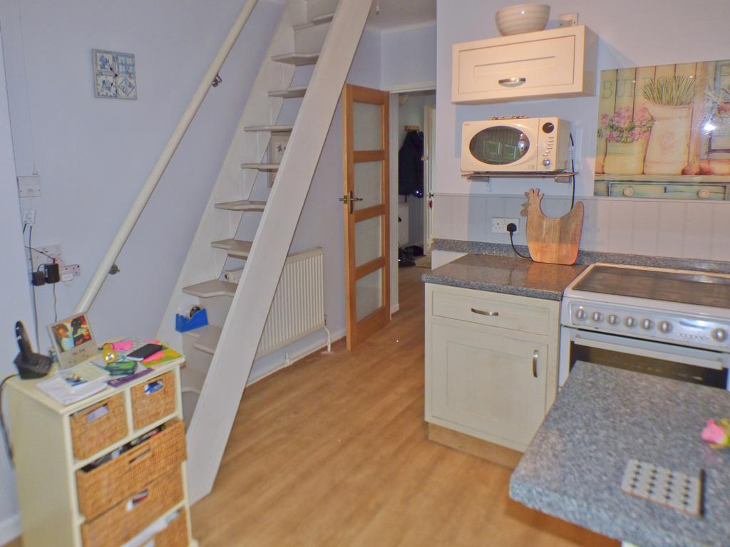Kitchen with loft access