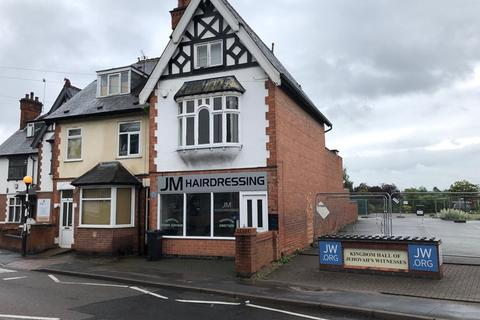 Retail property (high street) for sale - Freehold Shop with flat in Leicester suburb