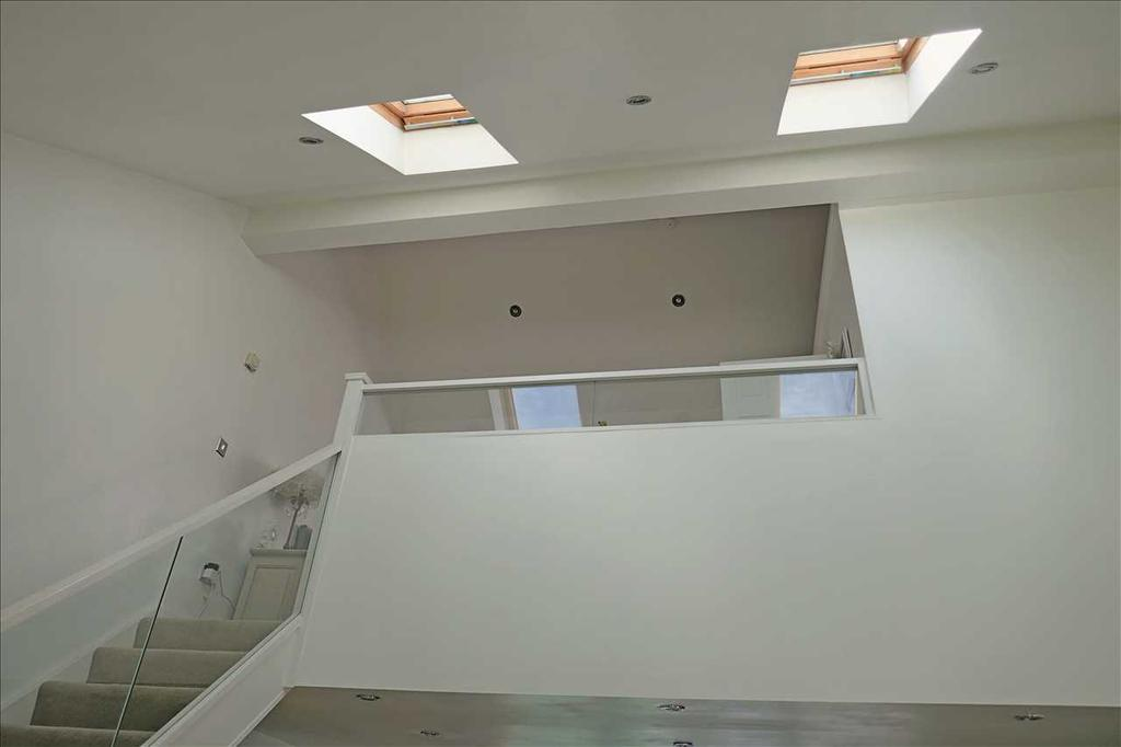 Staircase from lounge to mezzanine gallery bedroom