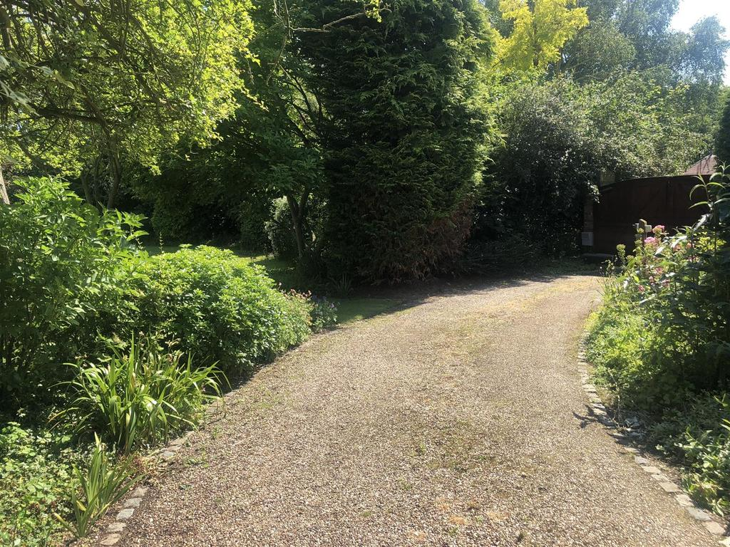 Second driveway to offices
