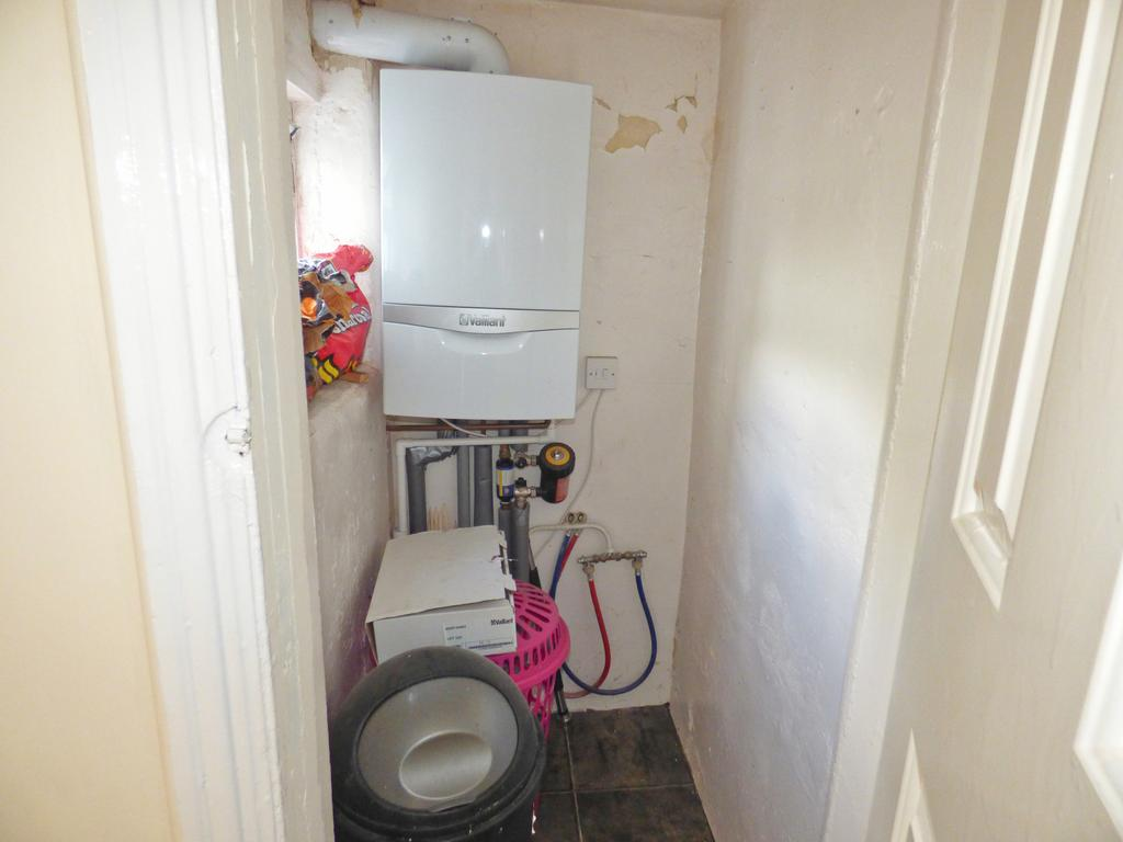 Storage cupboard with boiler