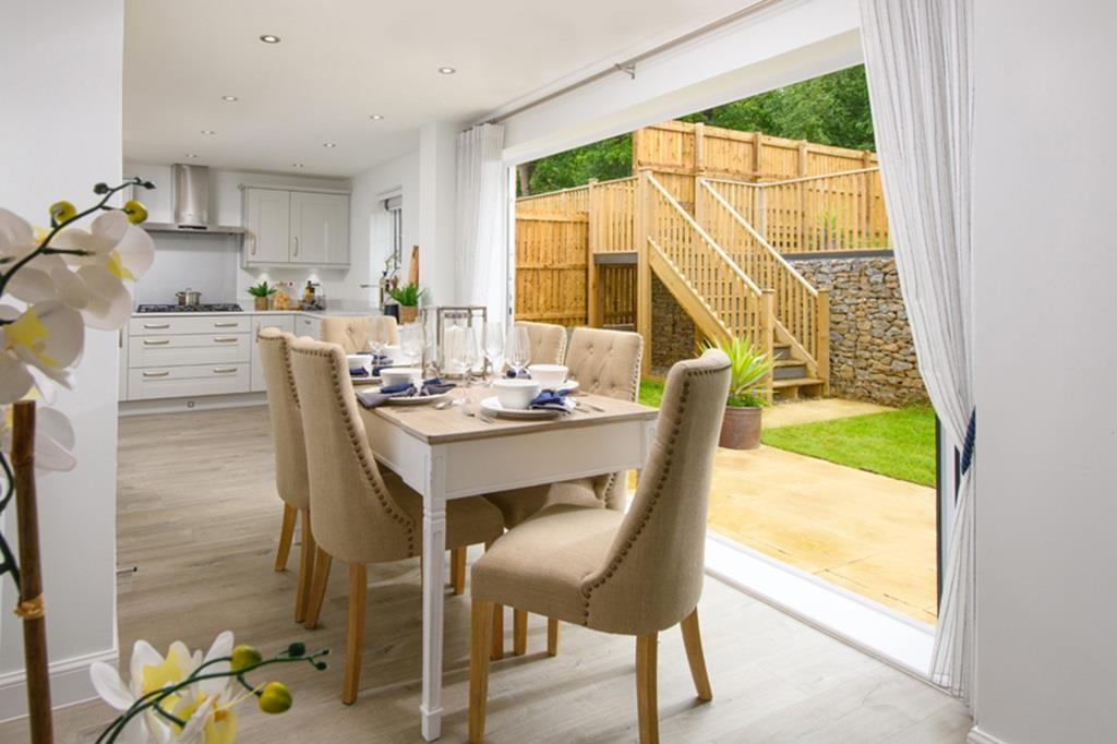 Allendale kitchen with dining area and bi fold doors opening onto garden