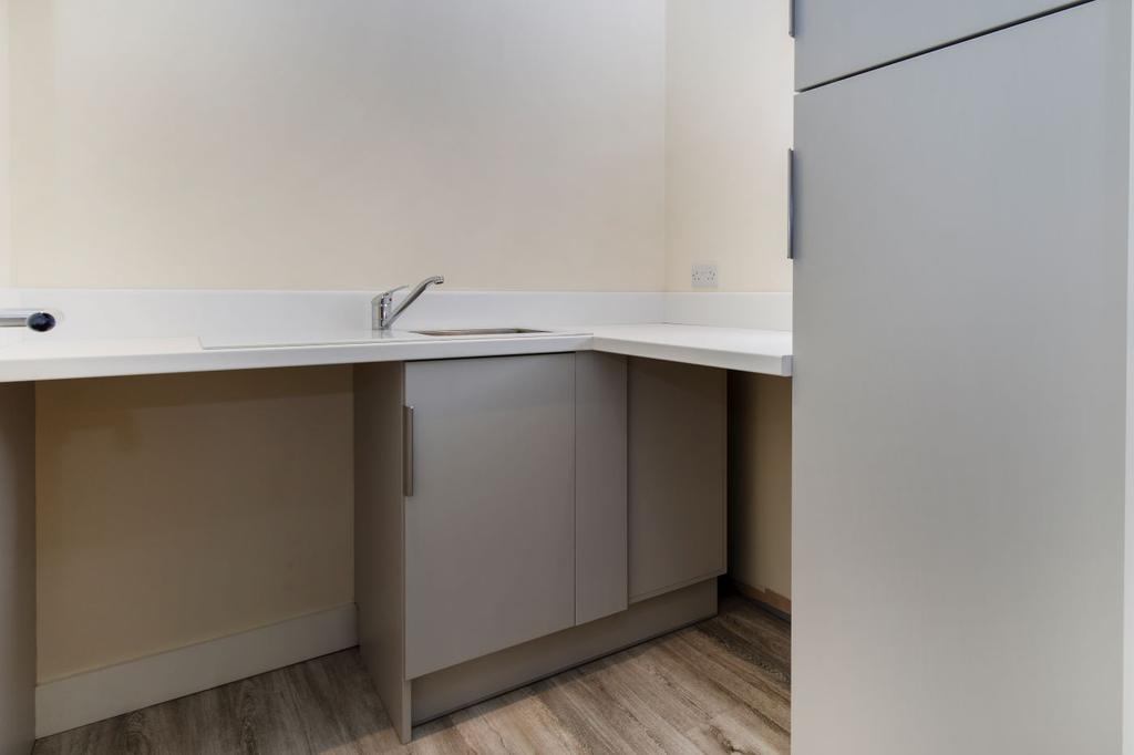 Utility room with space for a washer and tumble dryer plus ample storage cupboards