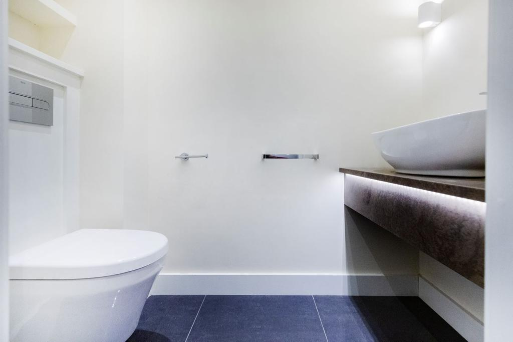 Back to Wall WC with soft close seat and dual flush