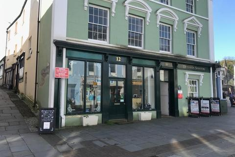 Retail property (high street) to rent - Ground Floor Retail Premises, 12 Dunraven Place, CF31 1JD