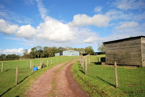 Land for sale - Approximately 13.23 Acres of agricltural/equestrian land with a large range of stables at Saith Farm