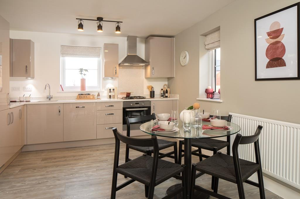 Open plan Kitchen within dining area in the Coleford Show Aparment at Ladden Garden Village, Yate