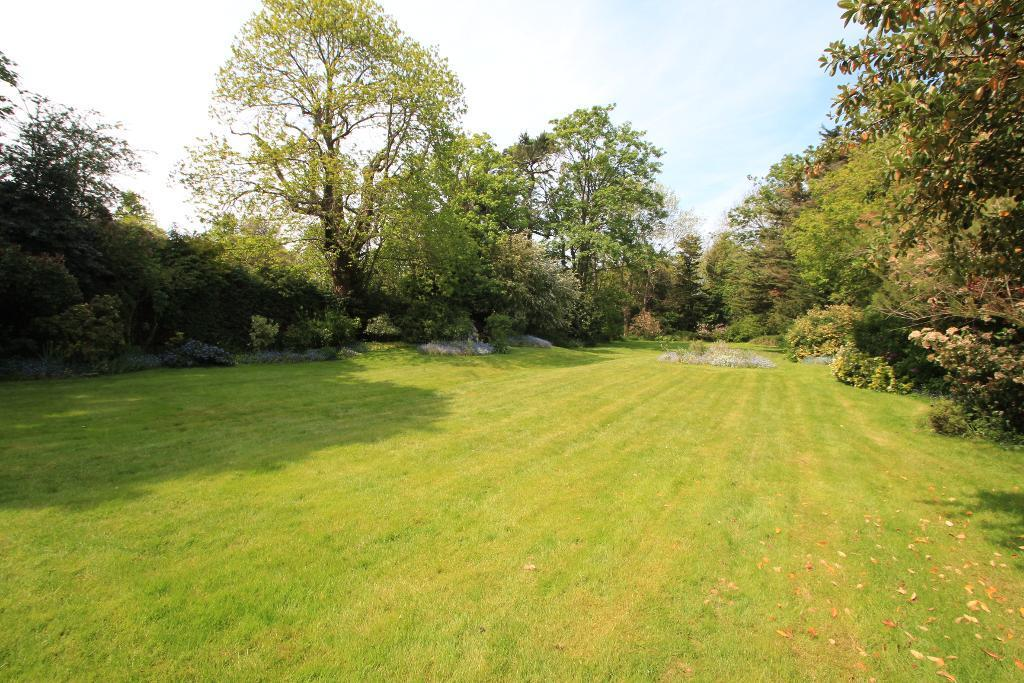 Stunning lawned gardens and woodland