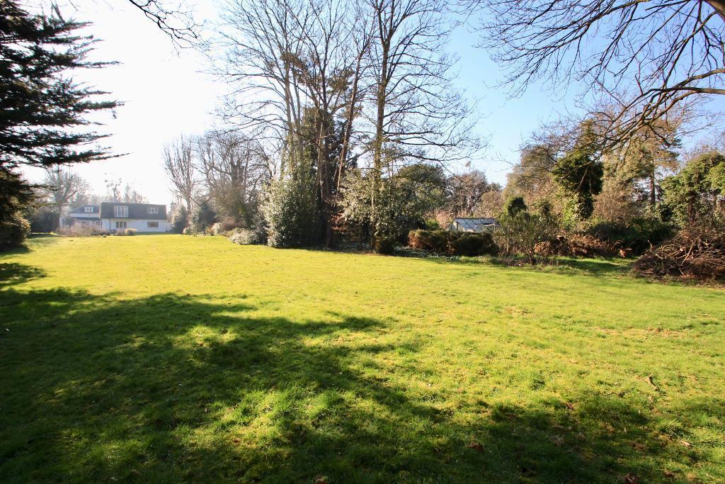 Around 1.25 acres gardens & woodland