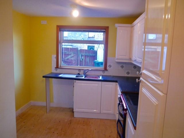 Kitchen with space for fridge freezer and washing
