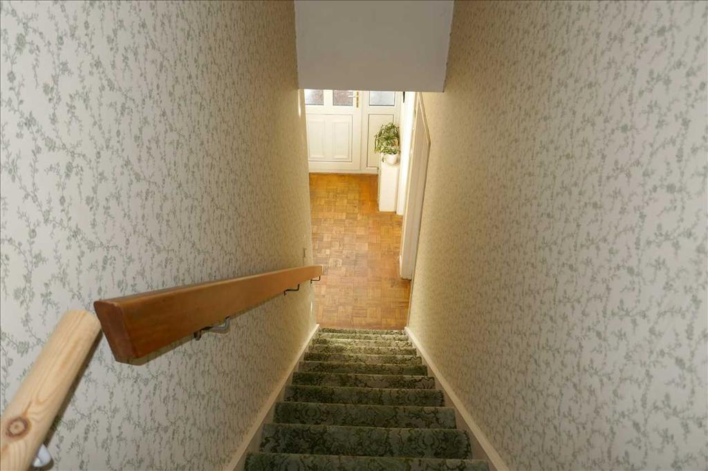 Staircase from hall to first floor landing