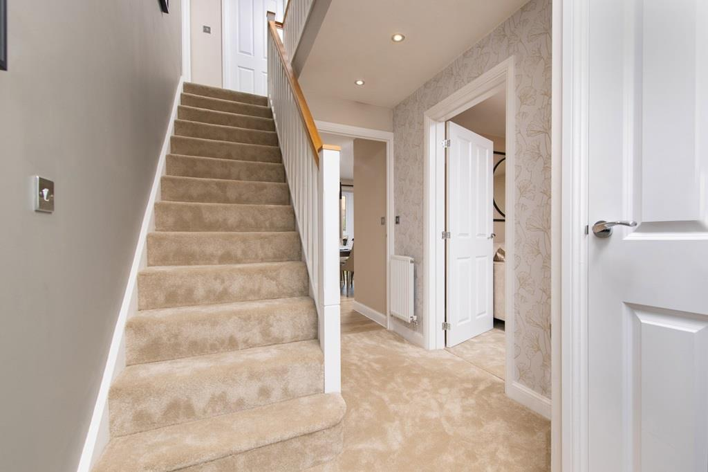 Hallway with view of upstairs in the Halton home