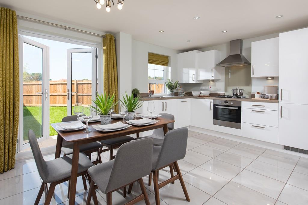 Internal image of Archford style kitchen with French doors to garden