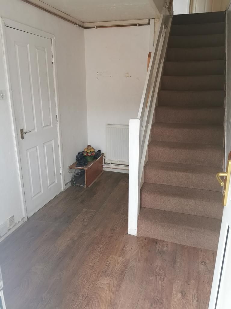 Hallway with access into garage