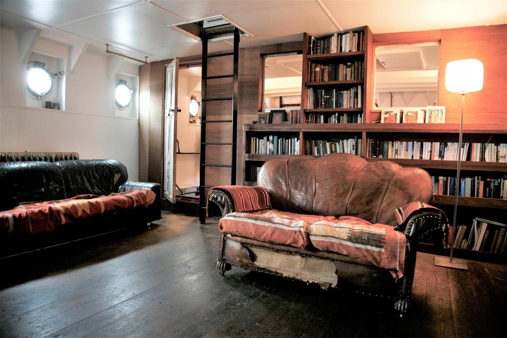 Light Vessel 93 reception area with cool leather seating and book shelf