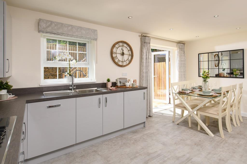Spacious kitchen with dining area and French doors to garden