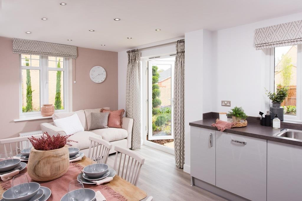 Open plan kitchen with dining/family areas and French doors
