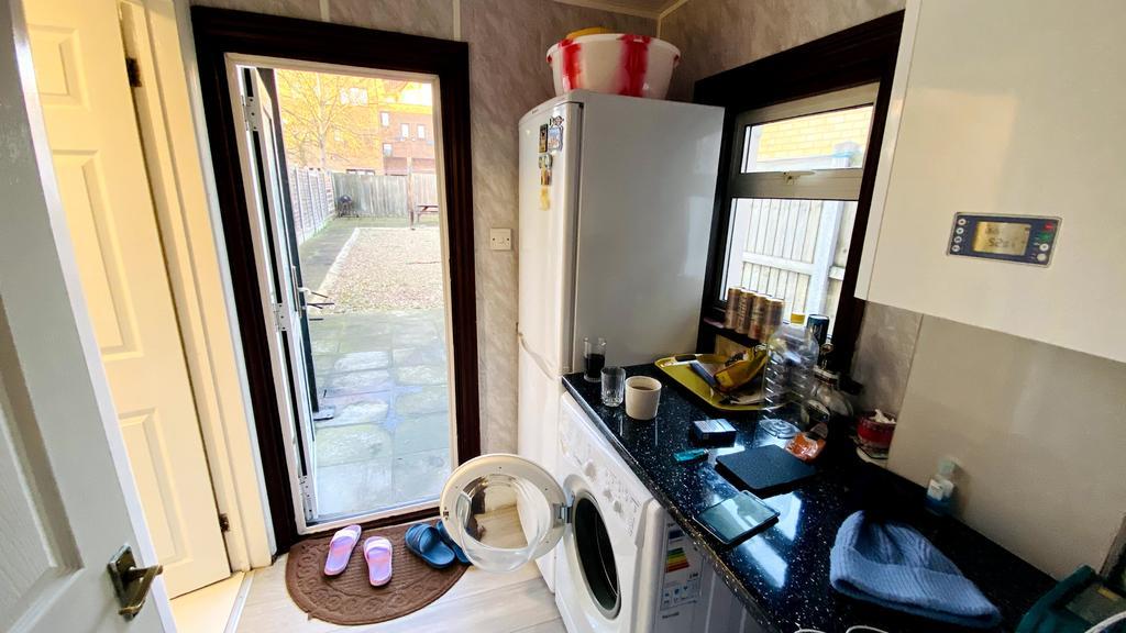 Utility room next to kitchen